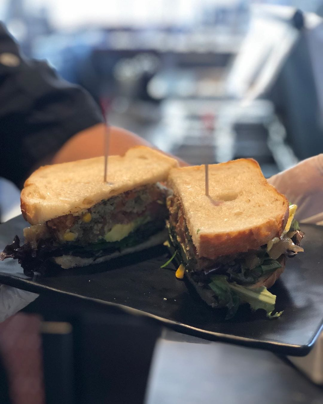 Looking for something light and healthy for lunch?! Try The Vegan Sandwich made with organic mixed greens, tomato, avocado and garlic aioli at @fireandbrew located at our Yard. #hotelzephyrsf #lunchideas #veganfood