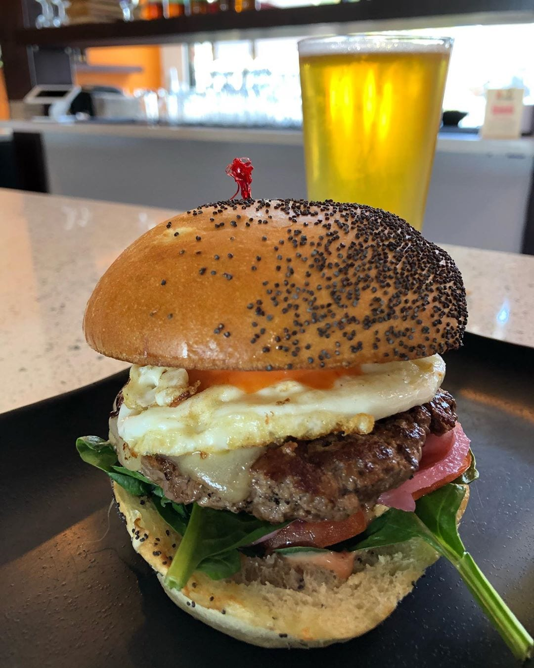 TGIF! Don't a nice juicy bison burger topped with fried egg, and cold beer sound good right now?! Try it @fireandbrew #tgif #fireandbrew #hotelzephyrsf #hotelzephyr #tgifridays #hh #happyhour