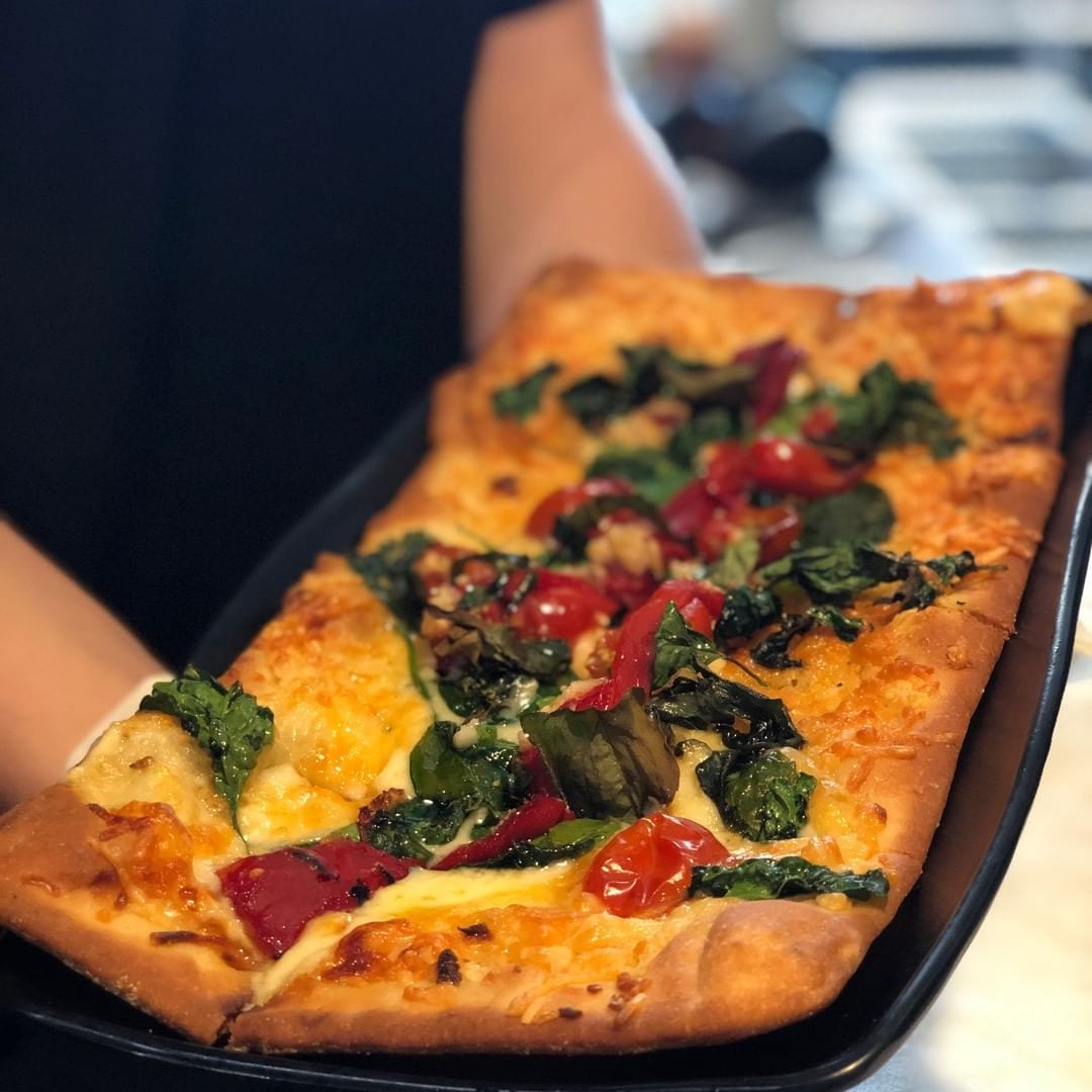 What's for lunch today? How about a crispy oven-baked flatbread at Zephyr Walk's @fireandbrew? It's made with white cheddar, gouda, blue cheese, ranch, basil, spinach, garlic, cherry tomatoes, and roasted pepper. #zephyrwalk #hotelzephyrsf #sodelish